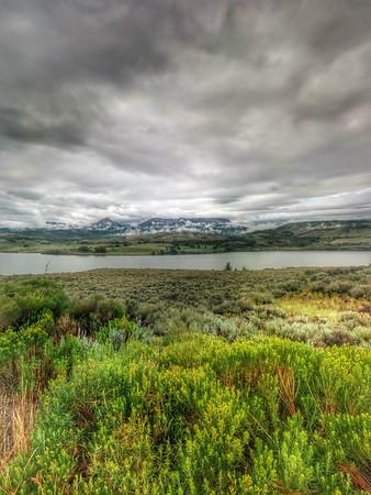 Meadows and Lake alongside highway, Colorado