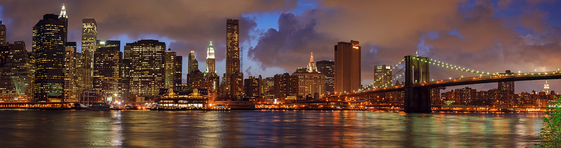 Panorama of the Brooklyn Bridge, the East River and Lower Manhattan at sunset from Brooklyn, New York City