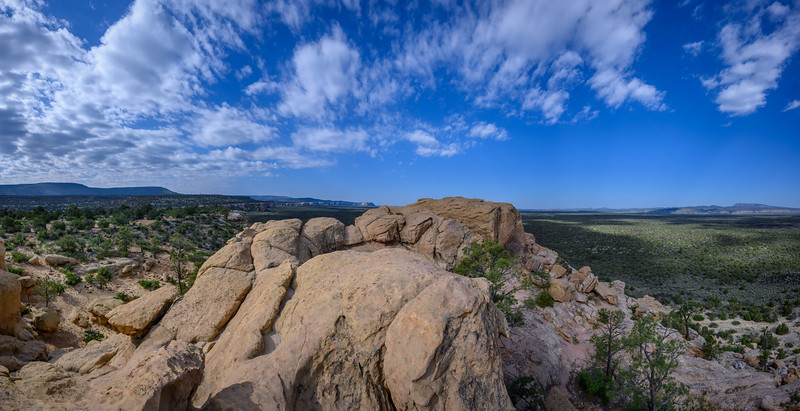 Panorama of sandstone cliffs and volcanic plain at El Malpais National Monument near Grants, New Mexico