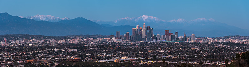 Los Angeles skyline at twilight with snow capped Mt. Baldy and Nike logo on Wilshire Grand