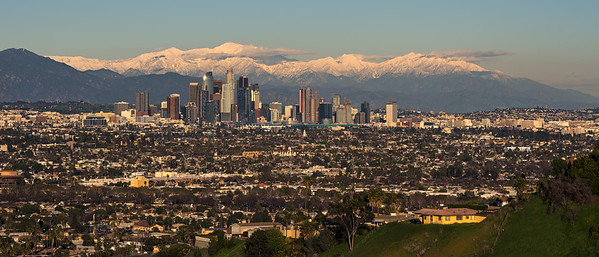 Los Angeles and snow capped San Gabriel mountains at golden hour