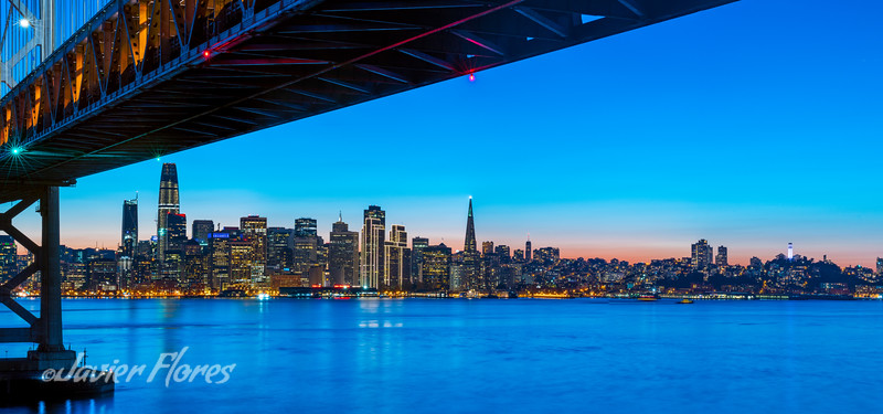 San Francisco skyline at sunset with Bay Bridge in the foreground