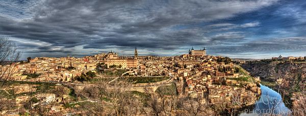 Panoramic shot of the town of Toledo.  A total of 9 photos were required to make this shot and it's full dimensions come out to be 13,624 x 5,167 pixels.... this calculates out to roughly 70.4 Megapixels... ENJOY!