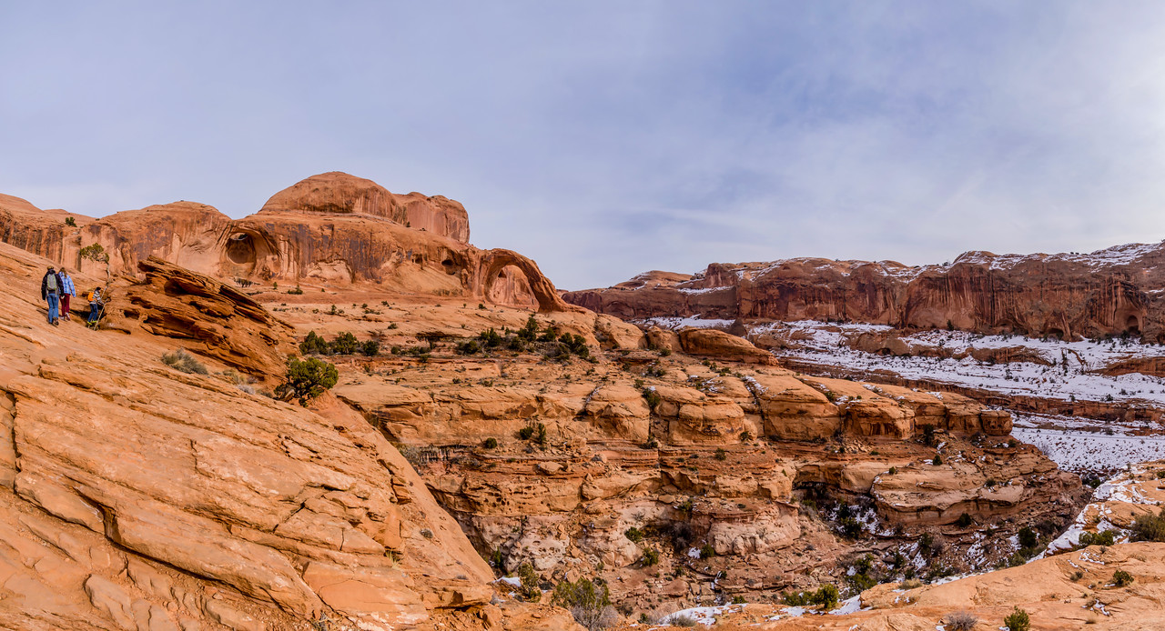 This panoramic view captures Matthew, Nikki, and Helen on the trail to Corona Arch.
