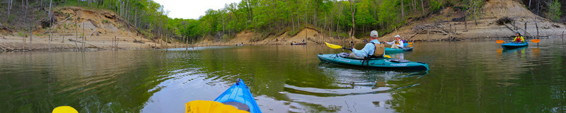 Cove Paddle<br /> (Apr 17) Paddling in a cove on East Fork Lake.  Several paddlers and lots of boats behind them fishing in the cove amoung the old trees sticking up through the water.