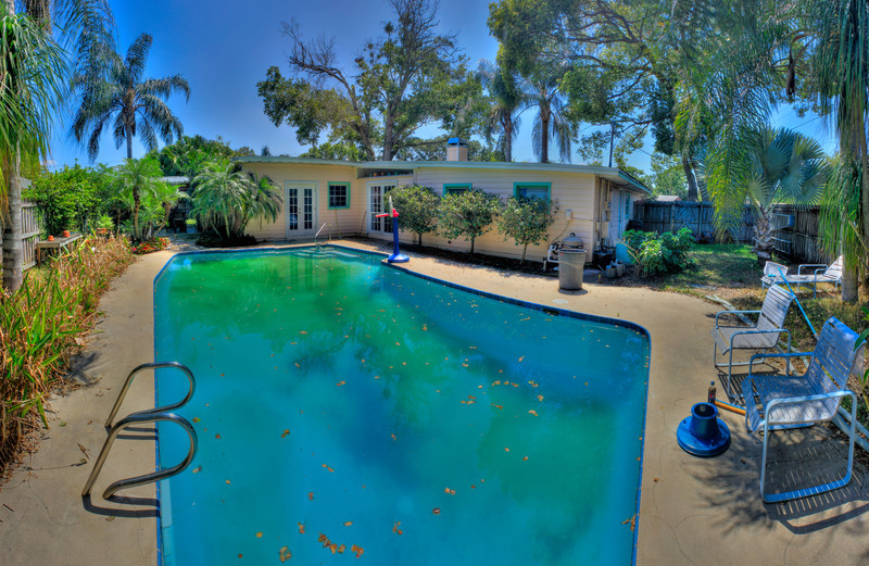 The Florida Life<br /> (Apr 3) The view of a backyard near Orland, Florida.  The pool, the palms and the sky.<br /> <br /> This is a 16 picture, 2 layer panoramic HDR.  So 52 photos make this whole thing.  I like the colors that came out and just love the shadows on the pool chairs from the queen palms.