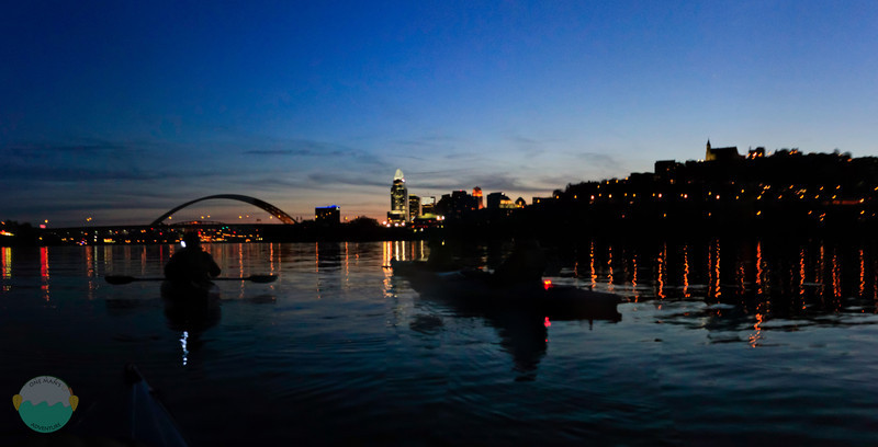 Kayaking into the Sunset<br /> (Apr 12) Kayaking on the Ohio River at dusk and beyond with Cincinnati as a backdrop to the 3 shadowy kayakers.<br /> <br /> As always the river is fun but crazy.  5 picture panoramic here.  Slightly hard to do in that light from a kayak.