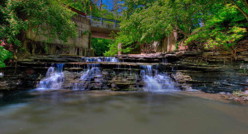 Edgewood's Wonder<br /> (Apr 27) This was my favorite shot of the day.  A falls that has a 1' drop followed by the larger 4' drop.  The greenery and the bridge made the image for me.  Visited 3 falls, all which had their own thing.  Learning and experimenting and exploring.  Enjoying it.  Trying different things, some that work adn some that horribly fail.