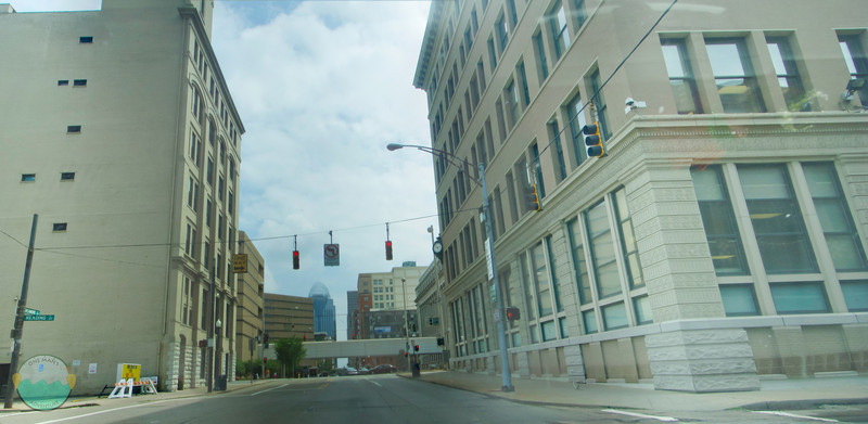 Through the Looking Glass<br /> (May 5) I forgot my memory card when I headed to OTR to take my panoramic of the day and took this with my pocket camera while driving downtown.  5 shot panormic.  Not great but oh well.