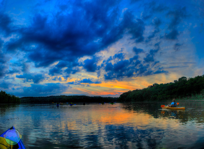 East Fork Beauty<br /> (May 8) The sunset over East Fork Lake in Clermont County, Ohio with a group of kayakers looking onward at its beauty.
