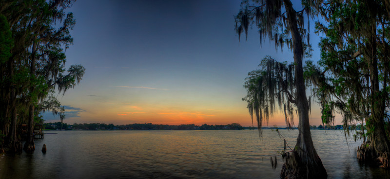 Florida Sunset<br /> (Apr 1) The sunset over Lake Maitland in Winter Park, Florida.  Cypress trees line both sides of the frame.  I wish I had taken more pictures of cypress trees while down there.  They really look pretty cool in hdr.