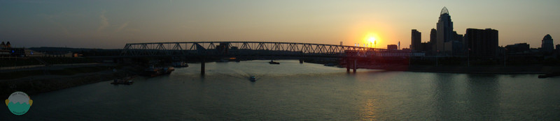 Going Home<br /> A boat speeds along as the sun sets on Cincinnati.  Taken from the People Purple Bridge.