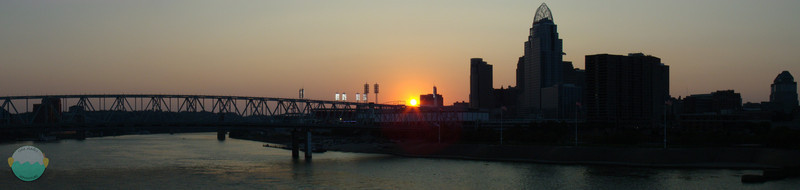 Sun Setting on the Reds Season<br /> The sun sets on the Reds game against the Cubs as the sun peaks as it falls below the stadium.  This is taken from the People Purple Bridge.