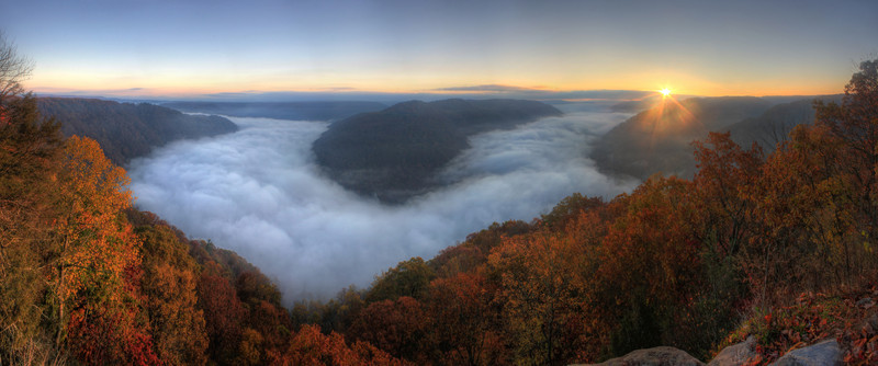Grandview<br /> A panoramic view of the fog filling in the valley down below as the sun rises for a new day.
