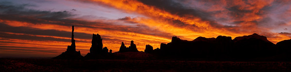 Monument Valley, AZ/Oct. A glorious sunrise appears over the famous rock formations Totem Pole and Yei Bichei.