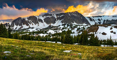 A summer sunset in the Snowy Range Mountains of Albany County, Wyoming. The high alpine landscape of southeast Wyoming is known for its mixture of lakes, nearly year-round snow and high altitude plants. Medicine Bow Peak is viewed from a turnout along the Snowy Range Scenic Biway near Laramie, Wyoming.   Photo by Kyle Spradley | © Kyle Spradley Photography | www.kspradleyphoto.com