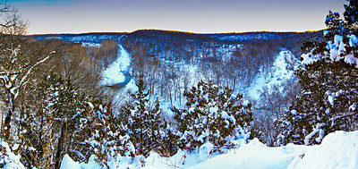 Winter snow storm at the Devil's Backbone in Boone County. The Cedar Creek meanders below the steep cedar bluffs in the Mark Twain National Forest - Cedar Creek District. The popular viewpoint is just east of the Columbia Regional Airport between Columbia and Ashland.  Photo by Kyle Spradley | www.kspradleyphoto.com