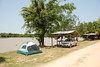 Our tent and rental car on the Rio cuiba.