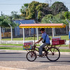 Ice Cream Peddler on Bicycle