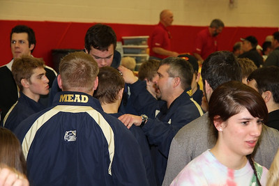 Coach McLean congratulates the team