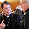 The archbishop speaks with Fr. Ed Kilianski, US provincial superior
