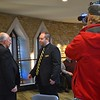 The archbishop is interviewed for the local television news