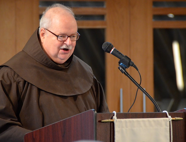 Fr. Steve Malkiewicz, associate director of Human Formation,  leads the opening prayer