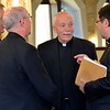Fr. Tom Knoebel, SHSST rector, greets the archbishop and other participants
