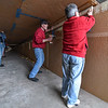 "Fitchburg mayor Stephen DiNatale (right), Joe Mello (center) and Jerry Beck assists in the installation of the top wing of a giant 64 foot paper airplane during a ""Meet the Plane"" media event held by  Project Soar at the Fitchburg Municipal Airport on Saturday.  SENTINEL & ENTERPRISE JEFF PORTER"