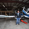 """Hanger co-owner and Rich Corley  generously donated space for the construction of the 64 foot paper airplane during a """"Meet the Plane"""" media event held by  Project Soar at the Fitchburg Municipal Airport on Saturday.  SENTINEL & ENTERPRISE JEFF PORTER"""