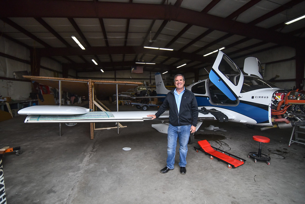 ". Hanger co-owner and Rich Corley  generously donated space for the construction of the 64 foot paper airplane during a ""Meet the Plane\"" media event held by  Project Soar at the Fitchburg Municipal Airport on Saturday.  SENTINEL & ENTERPRISE JEFF PORTER"