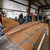 "A crew of people prep the top wing for installation during a ""Meet the Plane"" media event held by  Project Soar at the Fitchburg Municipal Airport on Saturday.  SENTINEL & ENTERPRISE JEFF PORTER"