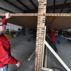"""Fitchburg mayor Stephen DiNatale assists in the installation of the top wing of a giant 64 foot paper airplane during a """"Meet the Plane"""" media event held by  Project Soar at the Fitchburg Municipal Airport on Saturday.  SENTINEL & ENTERPRISE JEFF PORTER"""