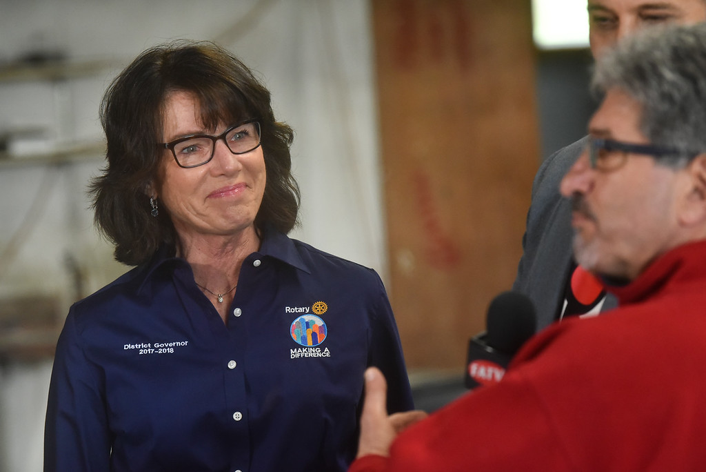 ". District Governor of Rotary 7910 Karin Gaffney attends the ""Meet the Plane\"" media event held by  Project Soar at the Fitchburg Municipal Airport on Saturday.  SENTINEL & ENTERPRISE JEFF PORTER"