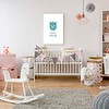 White poster mockup over crib