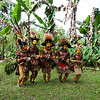 """Our """"greeting committee"""": Huli Wigmen do a welcoming Sing-Sing dance for us. Tari Highlands, Southern Highlands Province, Papua New Guinea"""