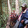 Some local children come out to see the foreigners as we cross the bridge in the forest. Tari Highlands, Papua New Guinea