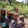 Some kids check out the foreigners walking along the roadway. Tari Highlands, Papua New Guinea