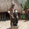 Village Elder with Mummy of poweful chief of DaniTribe from about 250 years ago. Baliem Valley, West Papua