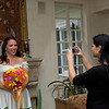 Snapshot time!: The makeup artist takes a snapshot of Courtney with her bouquet