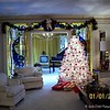 "January 1, 2006<br /> <br /> The house that Elvis Presley built was elaborately decorated just as Elvis had done for the holidays up until his untimely death. ""Graceland is a mansion on a 13.8-acre (5.6 ha) estate in Memphis, Tennessee, United States, that was owned by Elvis Presley. It is located at 3764 Elvis Presley Boulevard in the vast Whitehaven community, about 9 miles (14.5 km) from Downtown and less than four miles (6 km) north of the Mississippi border.[5] It currently serves as a museum. It was opened to the public on June 7, 1982. The site was listed in the National Register of Historic Places on November 7, 1991, and declared a National Historic Landmark on March 27, 2006. Graceland is the second most-visited house in America with over 650,000 visitors a year; second only to the White House.[6] [7][8]"" <br /> <br /> ~ Reprinted text from Wikipedia here: <br /> <br /> <a href=""https://en.wikipedia.org/wiki/Graceland"">https://en.wikipedia.org/wiki/Graceland</a><br /> <br /> ""GRACELAND MANSION"" 2006<br /> 3734 Elvis Presley Blvd.<br /> Memphis, TN 38116<br /> <br /> Official website: <br /> <br /> <a href=""http://www.graceland.com"">http://www.graceland.com</a>"