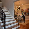 October 23, 2016<br /> <br /> ASHTON ABBEY<br /> <br /> NOTE: In my opinion, this home featured the best foyer/entry! My hubby and I love how the stairs can be ascended/descended from this side or the family room.<br /> <br /> As its name would imply, Ashton Abbey is a spectacular home with such a feeling of space, timelessness and grandeur that the technology and modern features incorporated into the construction almost become a reminder that it is, indeed, 2016.<br /> <br /> Designed and built with the today's on-the-go family in mind, Ashton Abbey is a 5224 square foot, two-story home situated on an estate lot. Step through the front door into a two-story foyer which extends to the two-story living room and right away you'll realize that this is an exceptional home.<br /> <br /> Encompassing four spacious bedrooms, four full bathrooms and two half-baths, Ashton Abbey boasts a Professional-style kitchen equipped with GE Monogram appliances. Off the kitchen is a large walk-through in which you'll find a built-in wet bar and a generous pantry. The kitchen looks out into the vaulted gathering room which is highlighted by one of the home's three fireplaces. The vaulted porch with its beautiful cedar work is just one of the impeccable exterior features of this home. <br /> <br /> Ashton Abbey boasts two double-car garages as well as a porte cochere. Escape from the main living spaces into the relaxing retreat of a spacious and well-appointed master bedroom, where you'll find not only a large bath with a walk-through shower and free-standing bathtub, but also an oversized master closet for him and her that connects to the laundry room for easy and convenient access.<br /> <br /> Upstairs in Ashton Abbey there are two bedrooms with private baths as well as a media room with the latest in technology and a playroom featuring a balcony overlooking the great room downstairs.<br /> Whether you are looking to entertain or be entertained, no detail has been overlooked in design