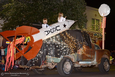 "A classic pickup carries a rocket to the moon during the 29th annual Parade of Lights Friday Oct. 13, 2018. The theme of ""Exploration: From Deep Sea to Deep Space (and everything in between!),"" was evident as spacemen and undersea creatures made their way down Main Street.  (Bill Husa -- Enterprise-Record)"