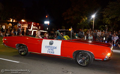 "The citizen of the year rides in a red classic car as hundreds or maybe thousands of Chicoans line the streets of downtown Chico during the 29th annual Parade of Lights Friday Oct. 13, 2018. The theme of ""Exploration: From Deep Sea to Deep Space (and everything in between!),"" was evident as spacemen and undersea creatures made their way down Main Street.  (Bill Husa -- Enterprise-Record)"