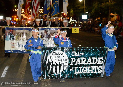 "The parade begins with these guys who carry the Parade of Lights banner. Hundreds or maybe thousands of Chicoans line the streets of downtown Chico during the 29th annual Parade of Lights Friday Oct. 13, 2018. The theme of ""Exploration: From Deep Sea to Deep Space (and everything in between!),"" was evident as spacemen and undersea creatures made their way down Main Street.  (Bill Husa -- Enterprise-Record)"