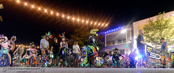 "A group of BMX riders perfom tricks along the route as hundreds or maybe thousands of Chicoans line the streets of downtown Chico during the 29th annual Parade of Lights Friday Oct. 13, 2018. The theme of ""Exploration: From Deep Sea to Deep Space (and everything in between!),"" was evident as spacemen and undersea creatures made their way down Main Street.  (Bill Husa -- Enterprise-Record)"