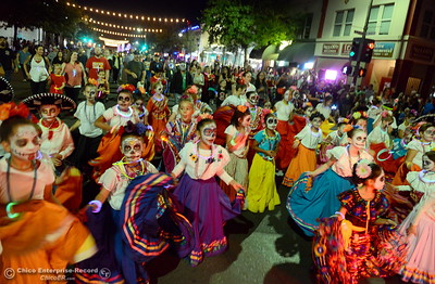 "Children celebrate the Day of the Dead as hundreds or maybe thousands of Chicoans line the streets of downtown Chico during the 29th annual Parade of Lights Friday Oct. 13, 2018. The theme of ""Exploration: From Deep Sea to Deep Space (and everything in between!),"" was evident as spacemen and undersea creatures made their way down Main Street.  (Bill Husa -- Enterprise-Record)"