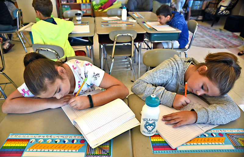 Working on letters and thoughts for students in Paradise Ca., that went through the wilkdfires, are Sullivan School 5thgrade students L-R, Miranda Moriarty and Evelyn Messentheimer. SUN/David H. Brow