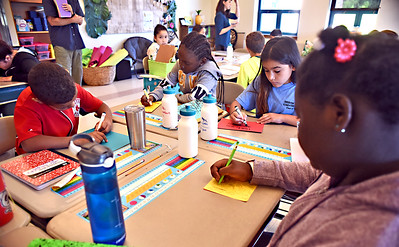 5th grade Sullivan School students write letters of comfort to students in Paradise Ca., that suffared tragic wildfires, L-R, Jaden Bridgewater, Aliha Mayombwe, Maya Ayala, and Ashley Phamor. SUN/David H. Brow