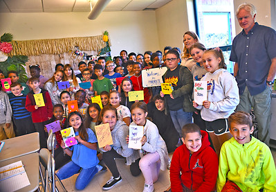Shown here is a mix of two  Sullivan School 5th grade classes holding the letters they wrote letters of comfort to the resident students of Paradise Ca., that had  suffared tragic fires in their community, standing on right is Robert Thompson (Social Worker at Sullivan School, and next to him 4th from right is 5th grade teacher Sherianne Kinney/other teacher not seen in this photo is Kim Broadhurst). SUN/David H. Brow